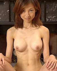 Heating the fireplace.   Slim Asian fuckwhore heating the fireplace with her seductive poses!. Click here for more photos!