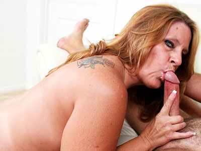 Penish gulp mature slut. Tanned mature slut filling her fat hungry mouth with huge cock. Click here for the gallery.
