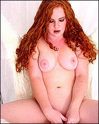 Chubby redhead melons massage. Chubby redhead taking the time out to plunge a dildo in her wet hole while squeezing her huge pink nipped tits. Download the free photos now!