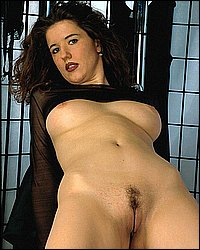 Busty brunette in black. Chubby brunette bitch displaying her huge hooters in her see through black blouse. Want more Click here now!