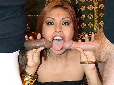 Tool stuffed indian roopa. Beautiful Indian chick Roopa sits down on a huge dick while she stuffs her mouth full of cock. Click here for more pictures.