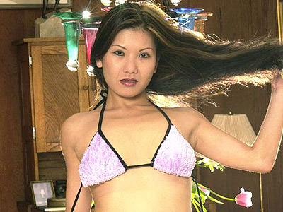 Lascivious asian cunt diddling. Lascivious Asian playfully stripping off her bikini to show off her boobs and play with her buttons. Click here for more photos!