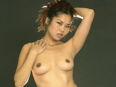 Hot asian solo tease. Sophisticated Asian model posing with nothing on but her undies show off her pretty trimmed muff. Click here to see the photos.