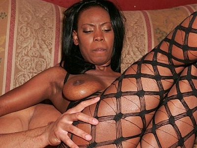 Tool stuffed ebony. Lascivious black porn babe swallowing a huge black cock and taking it in her cunt. Click here for more pictures.