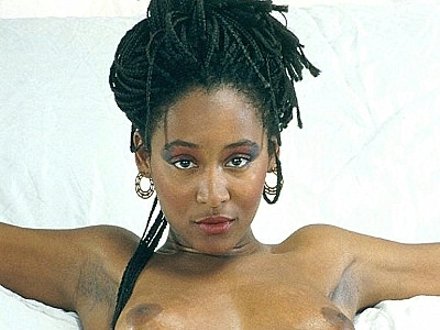 Hairy ebony naked. Sassy ebony pornstar strips off her clothes to play with her boobs and thick bush. Download the free photos now!