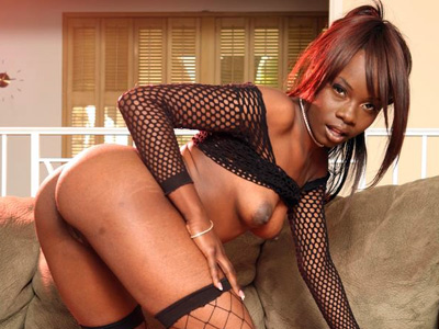 Stocking clad ebony solo. Phat anal ebony Ashley Brooks pulls up her top to unlease her natural tits and exposes her round ass. Click here to see the photos.