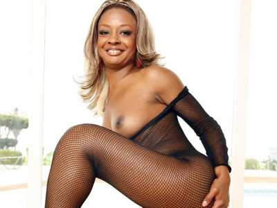 Curvy ebony vixen fyre. Black pornstar Vixen Fyre exposes her horny curves and rips her bodystockings to finger her pussy. Click here for more pictures.