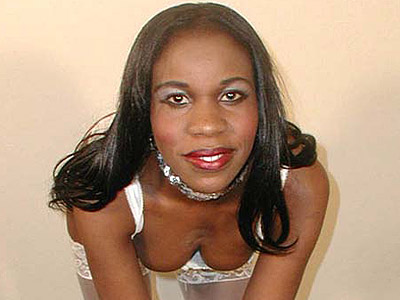 Strip teasing black babe.   Naughty black stripping down to her white stockings. Click here to view this gallery.