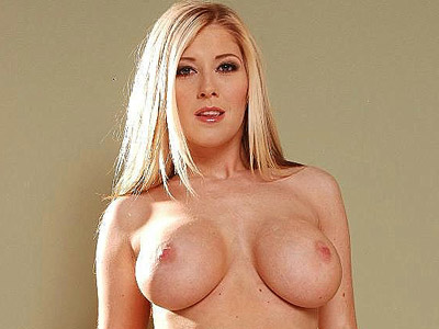 Stacked blonde jizzed. Blonde Michelle B follows a hunk into the bathroom and seduce him by showing off her big boobs. Click here for more pictures.