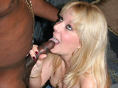 Dick slurping wife kami. Cumshot loving housewife Kami gets covered with black juice after cock sucking off a considerable black dong. Click here for the gallery.
