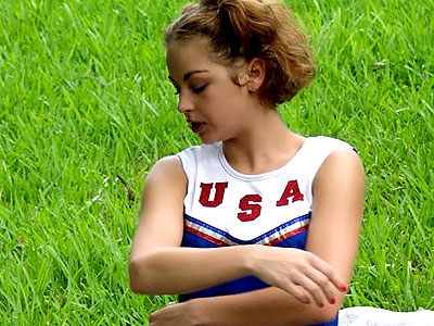 Nice cheerleader striptease. Nice Cheerleader does her movies outdoor before taking off her uniform and buffing her pussy. Click here for more pictures.
