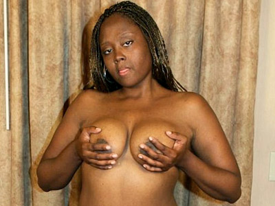 Hyphy ebony striptease. Hot stacked ebony Hyphy playing with her voluminous chocolate bazooms and showing off her booty. Click here to view this gallery.