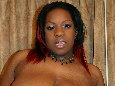 Black plumper crystal clear stripping. Huge babe Crystal Clear bends over to show off her big black anus before she strips off. Click here to see the photos.
