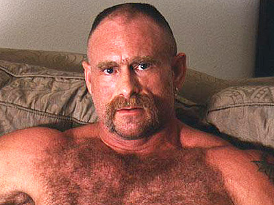 Live clip of tough looking gay bear naked on the couch and playing with his ...