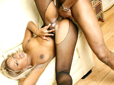 Exciting black anal pounding. Lusty lady Vixen Fyre wears her nasty fishnet outfit while getting her black bum pounded. Click here for more pictures.