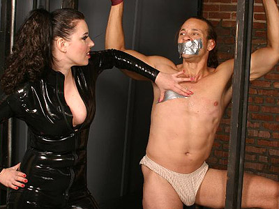 Anastasia caged and gagged. Male slave takes extreme BDSM punishment from lascivious female mistress Anastasia Pierce. Check it out for more preview pictures!
