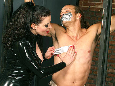 Mistress anastasia bounds slave. Mistress Anastasia Pierce bounds her insolent male submissive with chains and duct tape. Click here for more pictures.
