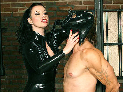 Anastasia pierce bondage punishment. Dominatrix Anastasia Pierce in black vinyl clothes bounds and whipping her ball gagged submissive. Click here to see the photos.
