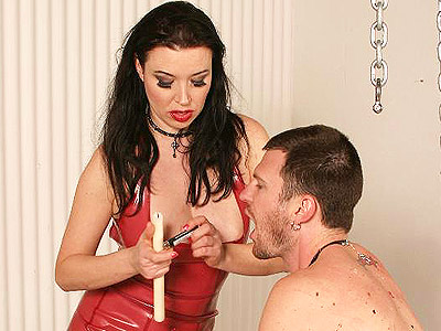 Excited domme anastasia pierce. Lascivious dominatrix Anastasia Pierce punishes her lascivious male servile with gagging and hot wax dripping. Download the free photos now!