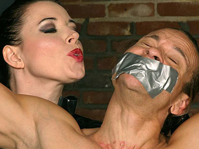 Anastasia bondage punishment. Mistress Anastasia Pierce bounds a guy in a cell and castigate him with duct tape gagging. Download the free photos now!