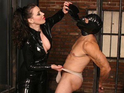 Dominatrix anastasia bondage play. Lascivious domme Anastasia Pierce restrains her male servient partner with chains and duct tape. Click here for more photos!