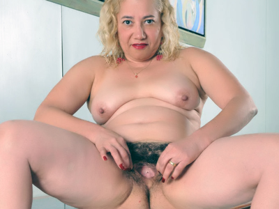 Ripe hairy kitty. Slutty mature Leenuh gets kinky and stuffs her mouth and ripe hairy cunt with a violent schlong. Want more Click here now!