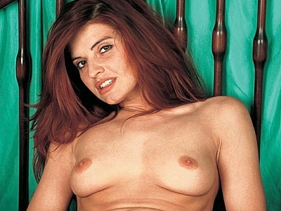 Exciting redhead hairy pussy rubbing. Excited redhead model unzips her dress to unleash her bouncy breasts and haired kitty slit. Download the free photos now!