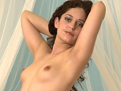 Hairy babe cunt tease. Exotic pornstar lifts up her top to show off her stiff nipples and thick haired muff. Click here to view this gallery.