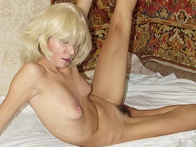 Hairy babe masturbating. Naughty Asian wearing a blonde wig naked and playing with her bush covered cunt slit. Click here for the gallery.