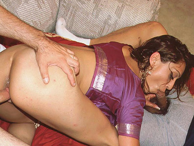 Indian babe threesome have intercourse. Beautiful porn babe Medaha Jangda playing with her tits and gets cock filling from both ends. Click here for more pictures.