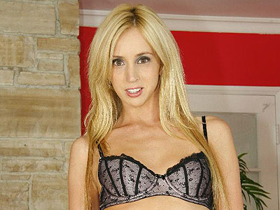 Kelly wells stripteasing. Blonde Kelly Wells grabs her tight butthole as she wiggles in her lascivious lacy panty. Click here for more photos!