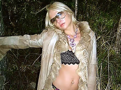 Outdoor lingerie tease. Pretty blonde shows off her libidinous lingerie under her fur coat in a titillating outdoor shoot. Check out for more high-res photos of this gallery!
