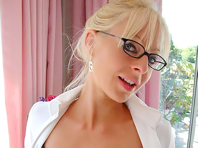 Office lingerie tease. Blonde secretary unbuttons her top to show off her boobs and exciting black lingerie. Download the free photos now!