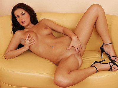 Masturbating brunette candy cat.   Brunette chick Candy Cat bend over the sofa to to play with her shaved pussy. Check it out for more preview pictures!