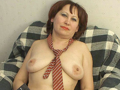 Horny mature mom stripping off her work clothes to show off her butt and ...