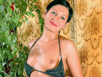 Stunning mature model slowly stripping off in front of the camera to show ...