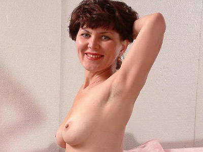 Mature Babe Live Striptease. Naughty mature model playfully taking off her ...