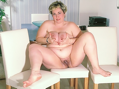 Old plumper tit play. Blonde plumper unleashes her huge knockers and kneads them while spreading her bushy cunt wide. Click here for more photos!