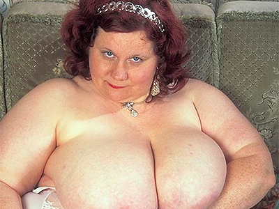 Busty mature bbw. This chunky older babe with a hard set of knockers loosens her negligee to play with her bazooms. Check it out for more preview pictures!