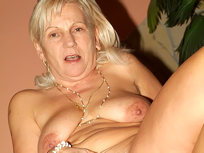 Blonde mature plumper Remy posing in her lingerie and bares it all to show ...