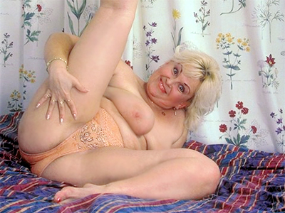 Fat mature blonde tease. Beautiful mature blonde with flabby breasts and a huge butthole bares it all to strut her goods for the camera. Click here for the gallery.