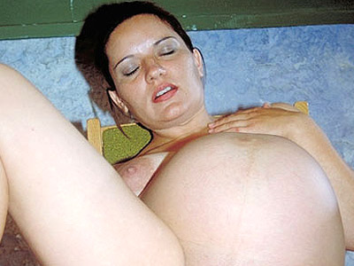 Cunt rubbed preggy babe. Great bellied hottie cuddling her wet pussy. Click here for more photos!