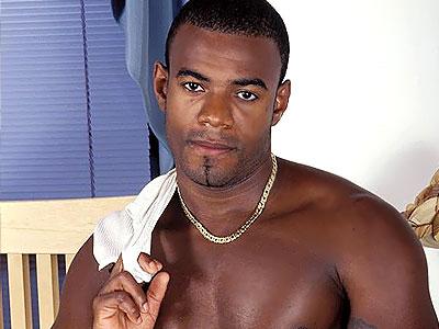 Huge Black Gay Cock. Well endowed black gay model playfully stripping off ...
