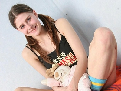 Teen panty stripping.   Innocent looking teen taking off her panties. Download the free photos now!