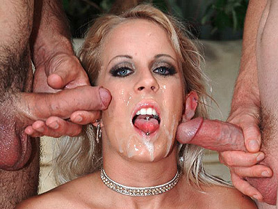 Cumshot drenched porn babe desire. Elegant blonde Desire Moore satisfied by cock sucking off two huge dicks and takes nasty raw glazing. Download the free photos now!