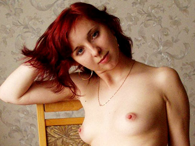 Petite redhead stripping. Redhead petite showing off her soft supple body. Download the free photos now!
